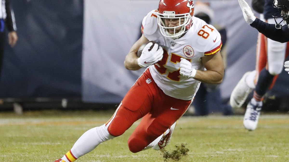 Kansas City Chiefs tight end Travis Kelce (87) runs after a catch against the Chicago Bears in the first half of an NFL football game in Chicago, Sunday, Dec. 22, 2019. (AP Photo/Charles Rex Arbogast)