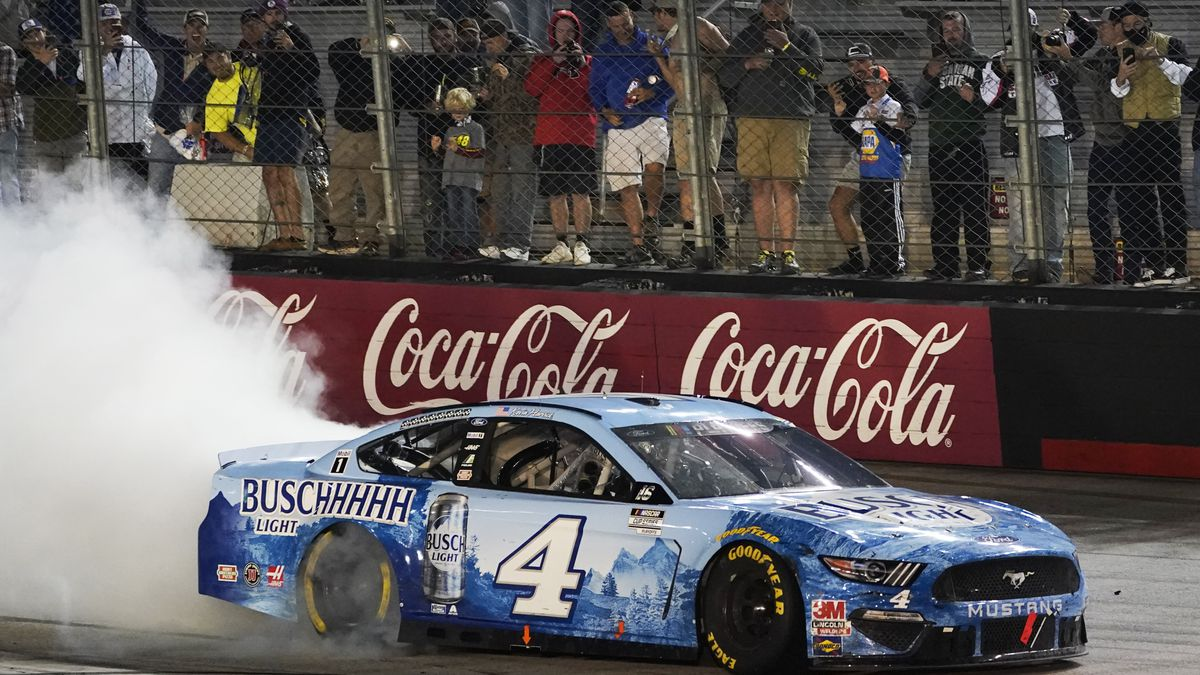 Kevin Harvick does a burnout after winning the NASCAR Cup Series auto race Saturday, Sept. 19, 2020, in Bristol, Tenn. (AP Photo/Steve Helber)