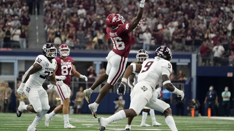 Arkansas wide receiver Treylon Burks (16) makes a one-handed catch between Texas A&M linebacker...
