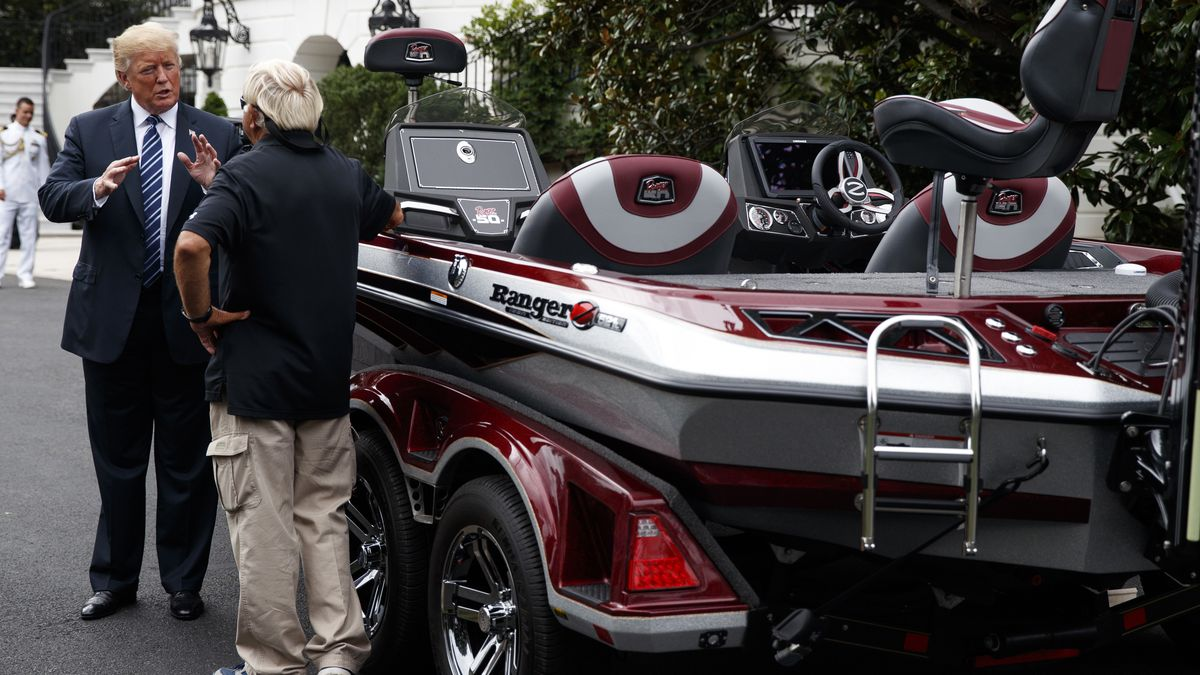 President Donald Trump talks with Jimmy Houston of Ranger Boats as he participates in a tour...