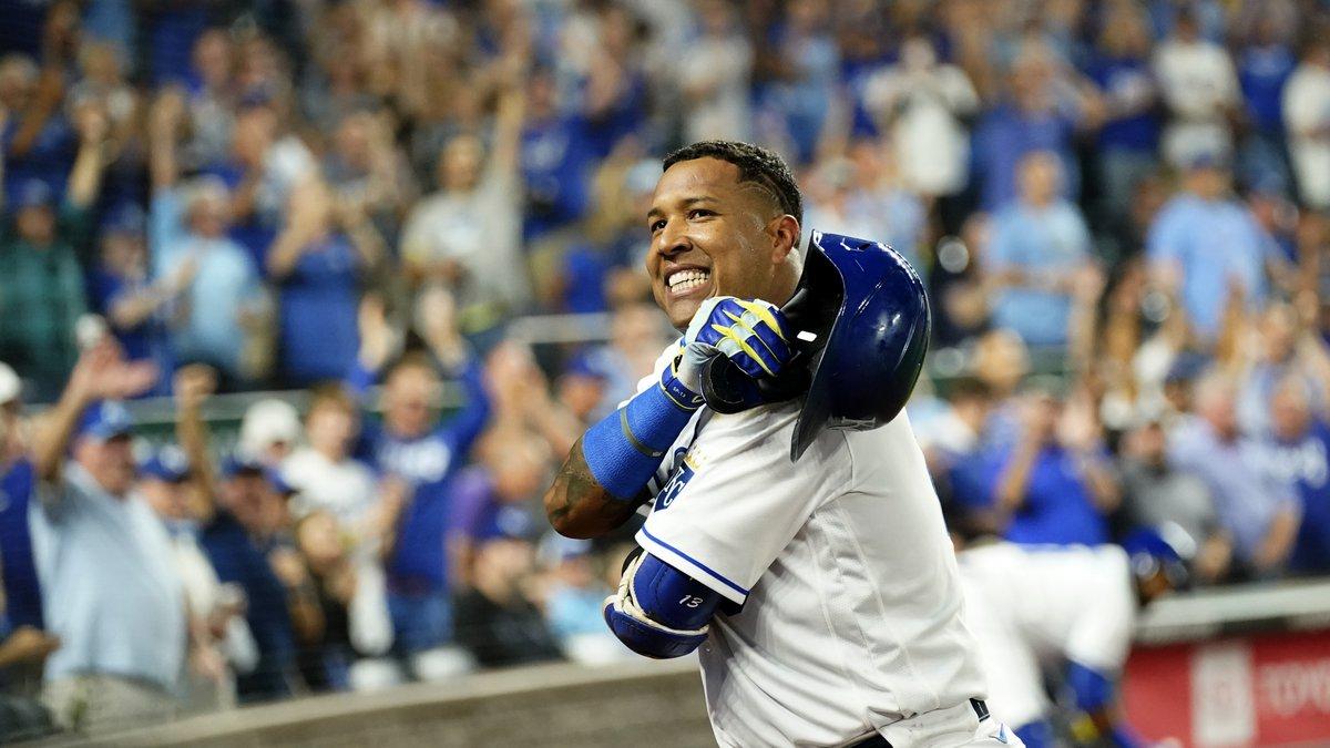 Kansas City Royals' Salvador Perez acknowledges the crowd after hitting a three-run home run...