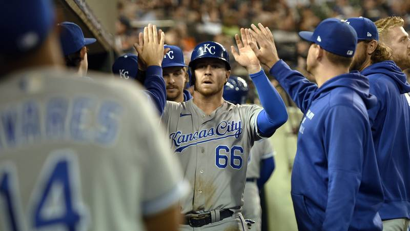Kansas City Royals' Ryan O'Hearn, center, is congratulated by teammates after scoring a run on...