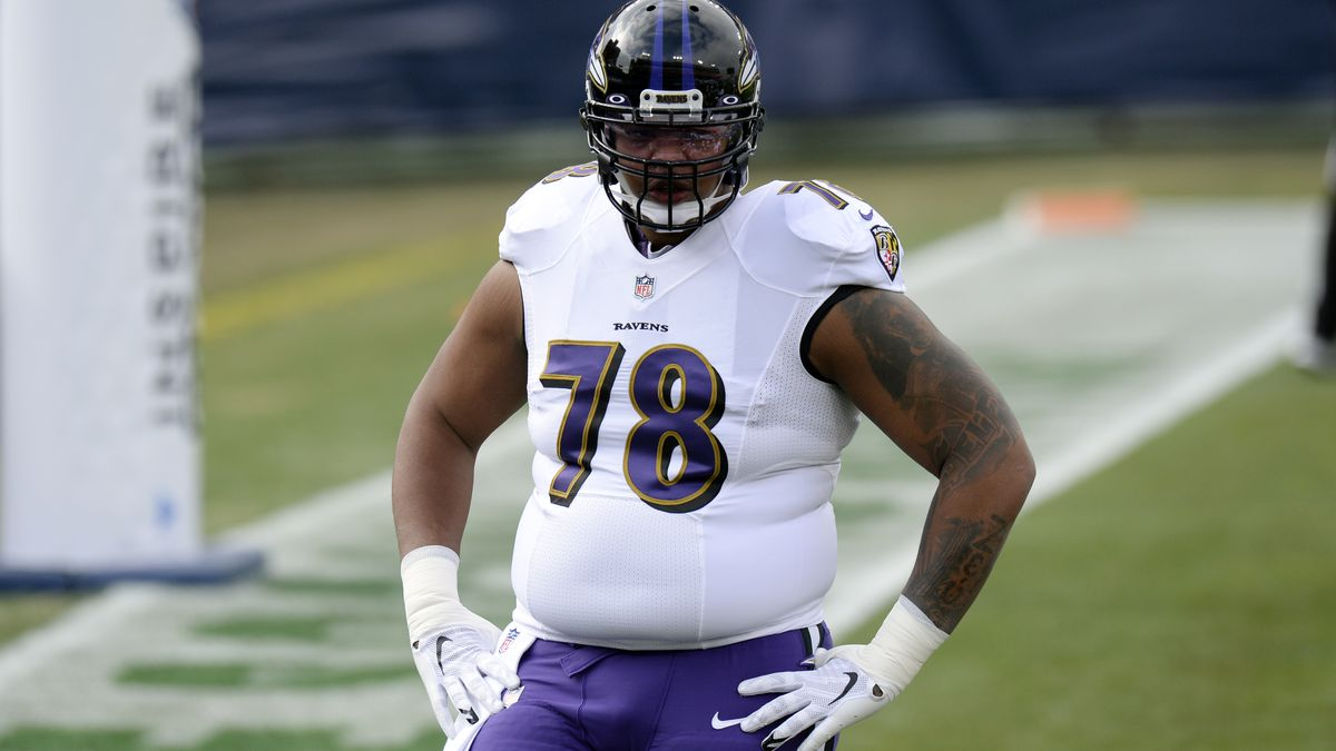 Baltimore Ravens offensive tackle Orlando Brown (78) warms up before an NFL wild-card playoff...