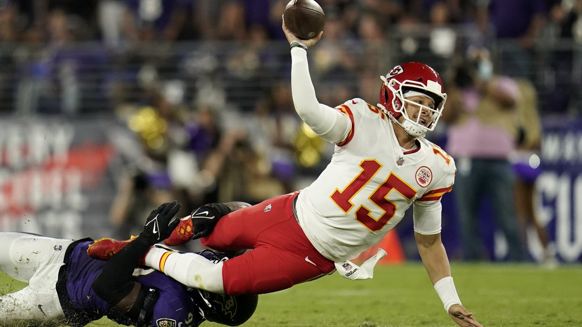 Kansas City Chiefs quarterback Patrick Mahomes makes a pass attempt as he is tackled by...