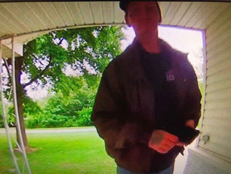 Doorbell security video shows the man has several tattoos.