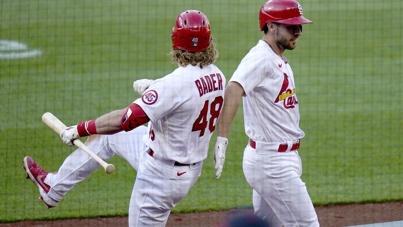 St. Louis Cardinals' Paul DeJong, right, is congratulated by teammate Harrison Bader (48) after...