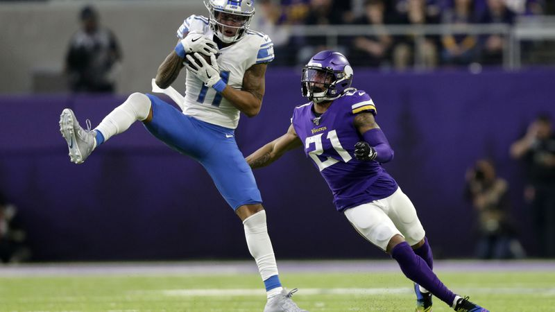 File-This Dec. 8, 2019, file photo shows Detroit Lions wide receiver Marvin Jones catching a...