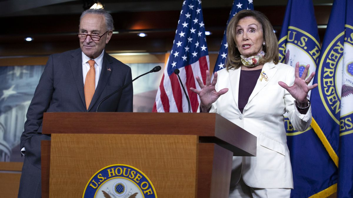 House Speaker Nancy Pelosi of Calif., joined by Senate Minority Leader Sen. Chuck Schumer of N.Y., speaks during a news conference on Capitol Hill in Washington, Thursday, Aug. 6, 2020.