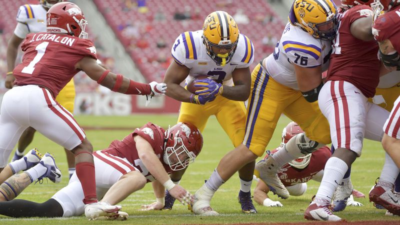 LSU running back Tyrion Davis-Price (3) finds a hole in the Arkansas defense as he runs for a...