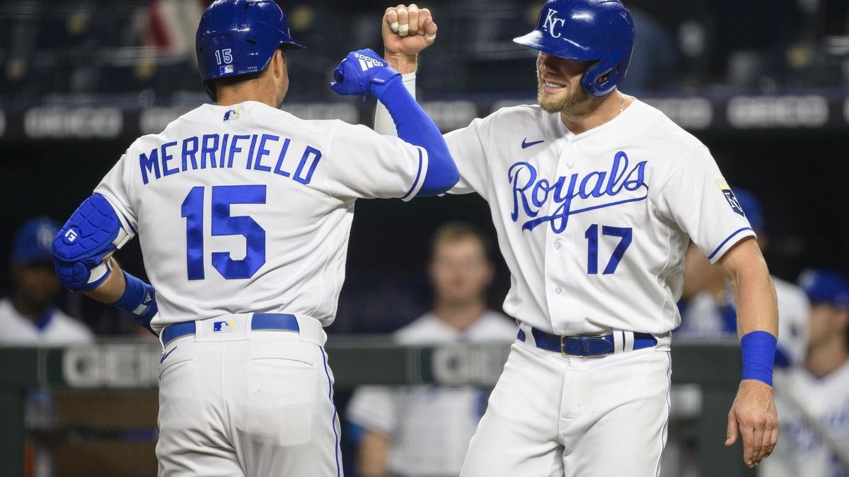 Kansas City Royals Hunter Dozier, right, congratulates Whit Merrifield, left, after Merrifield...
