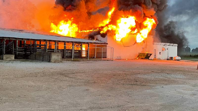 Roberts Bros. Livestock Auction caught fire Monday morning, resulting in a total loss.