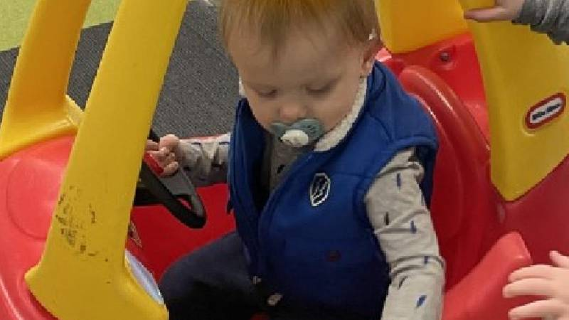 Twin boys play at indoor playground.