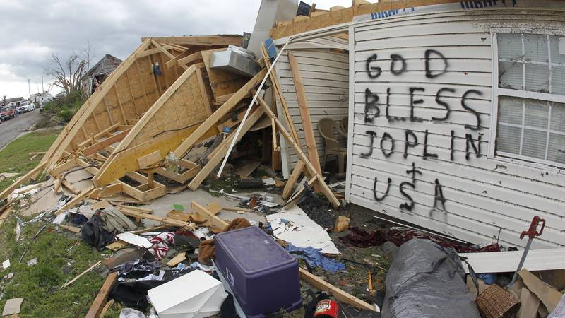 A message is painted on a tornado-destroyed home on Wednesday, May 25, 2011, in Joplin, Mo. (AP...
