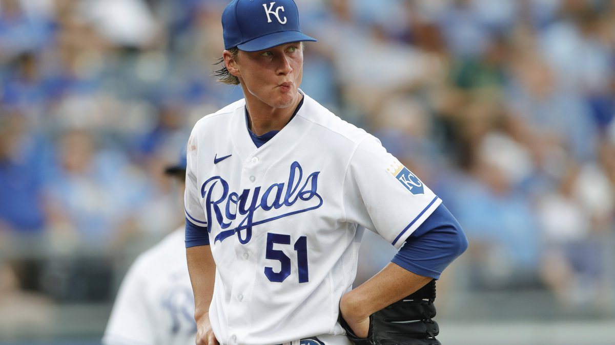 Kansas City Royals pitcher Brady Singer reacts after the Baltimore Orioles scored their sixth...