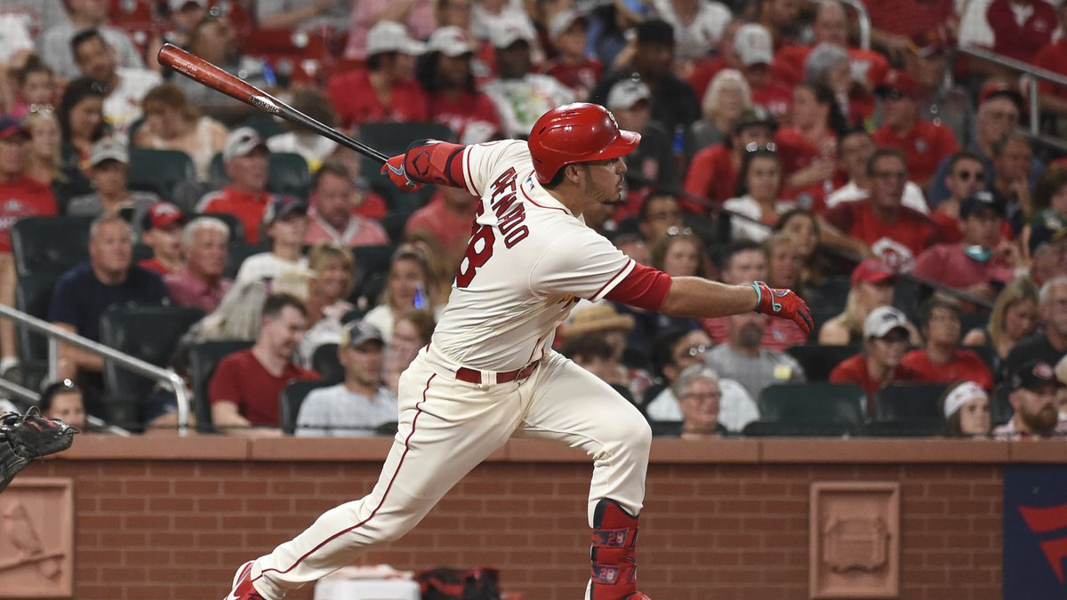 St. Louis Cardinals' Nolan Arenado watches his RBI-triple during the sixth inning of a baseball...