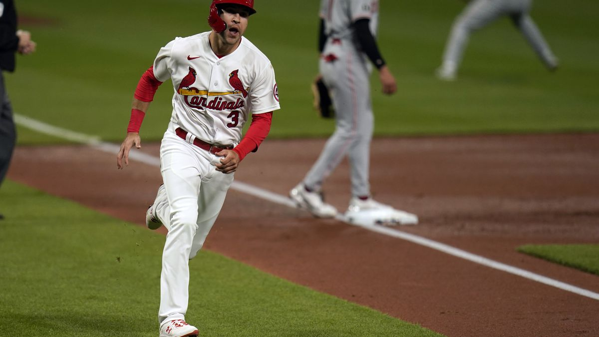 St. Louis Cardinals' Dylan Carlson (3) heads home to score on a two-run double by Paul...