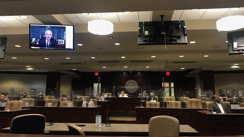 FILE - In this Nov. 10, 2020 file photo, Arkansas Gov. Asa Hutchinson speaks remotely to...