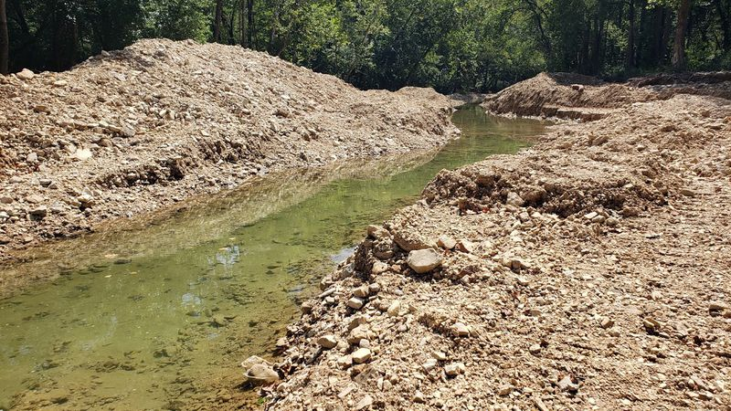 Some are concerned about damage done to Bull Creek when a problem low water bridge was removed.