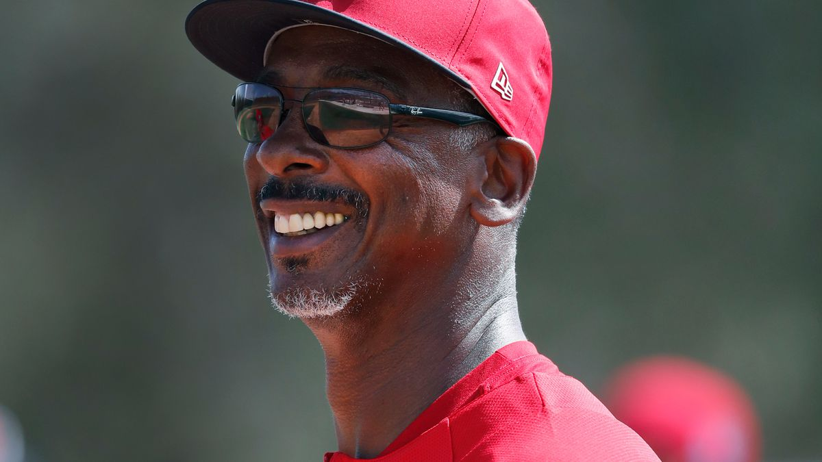 St. Louis Cardinals assistant coach Willie McGee smiles during spring training baseball...