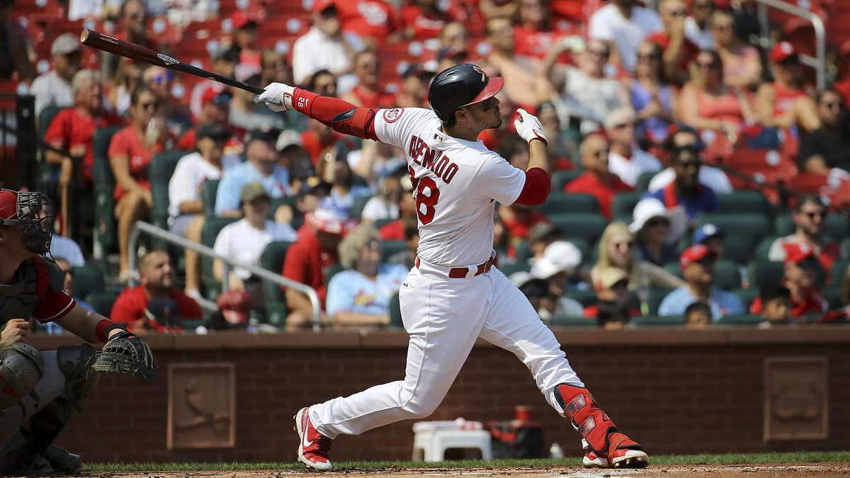 St. Louis Cardinals' Nolan Arenado watches his two-run home run ball during the first inning...