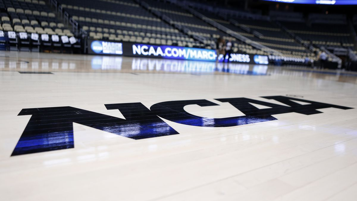 FILE - In this Wednesday, March 18, 2015 file photo, The NCAA logo is on the court as work continues at The Consol Energy Center in Pittsburgh. Imagine an NCAA Tournament with no fans in the arenas. What normally would be thought an impossibility isn't so far-fetched as the United States and the rest of the world attempt to contain the spread of the new coronavirus.  (AP Photo/Keith Srakocic, File)