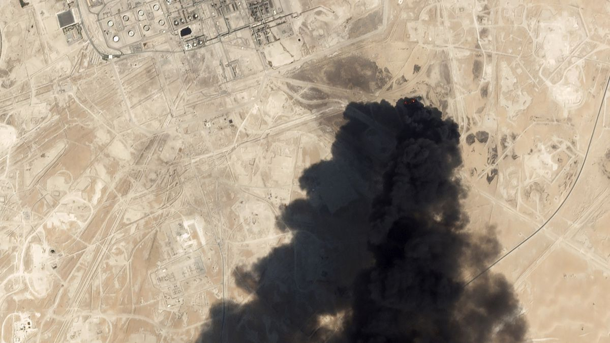 This Saturday, Sept. 14, 2019, satellite image from Planet Labs Inc. shows thick black smoke...