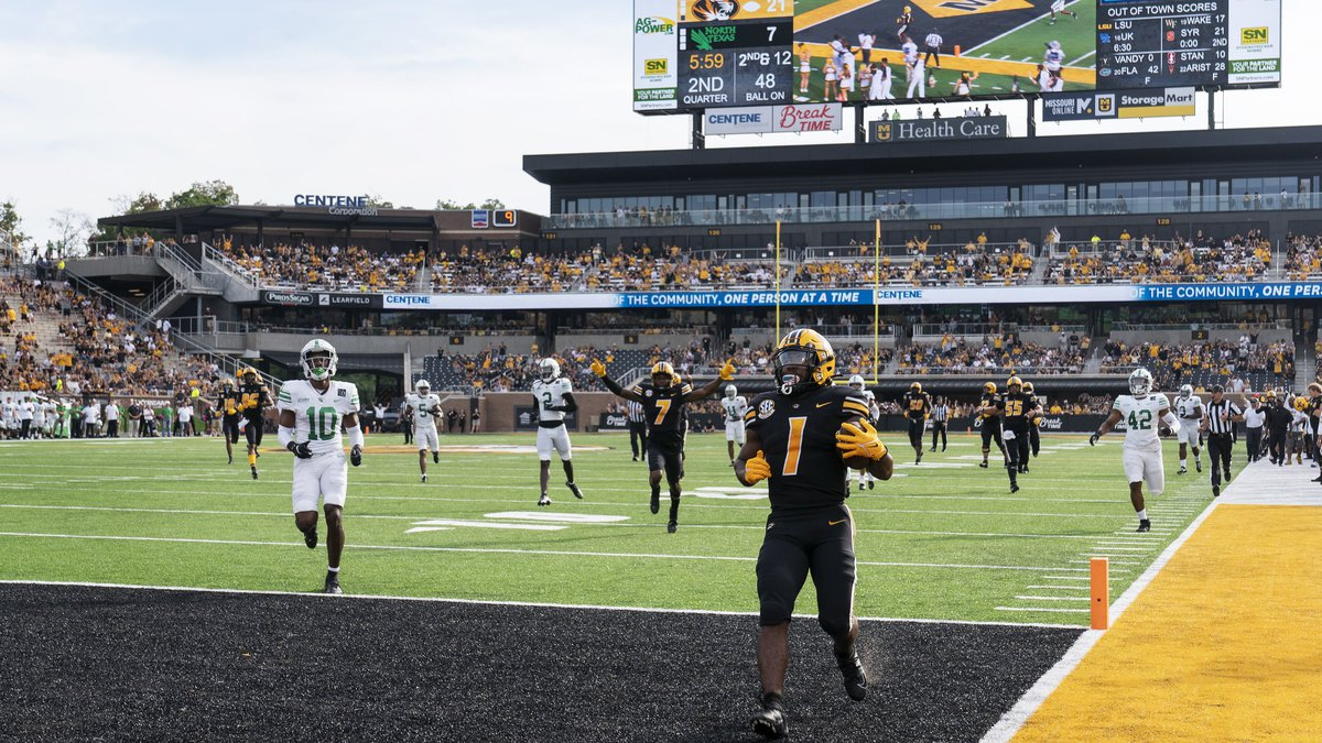 Missouri running back Tyler Badie (1) scores a touchdown during the second quarter of an NCAA...