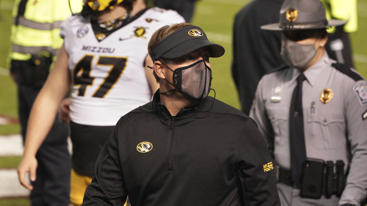 Missouri head coach Eliah Drinkwitz walks off the field after an NCAA college football game...