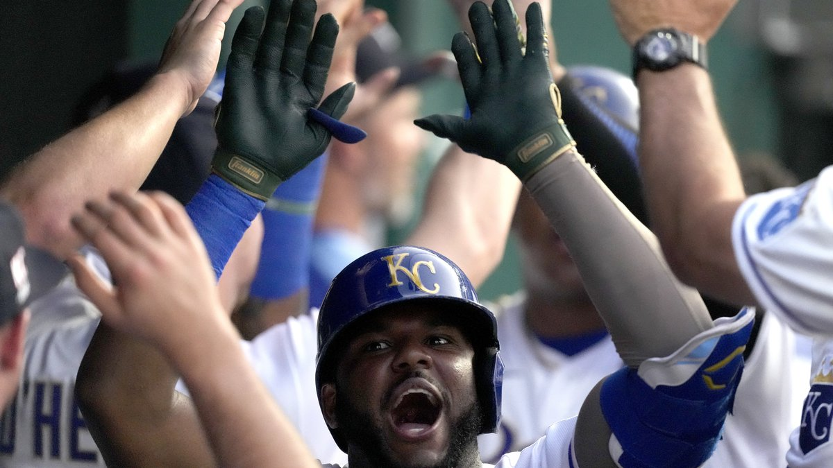 Kansas City Royals' Hanser Alberto celebrates in the dugout after hitting a two-run home run...