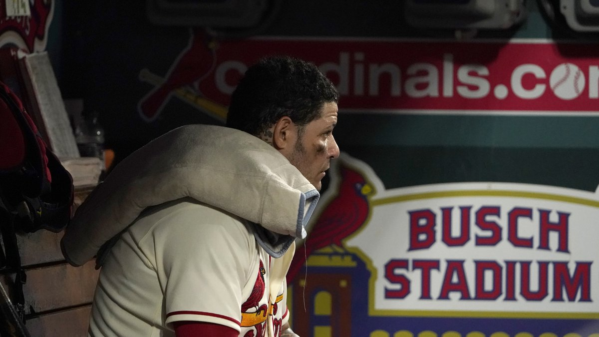 St. Louis Cardinals catcher Yadier Molina sits in the dugout during the second inning of a...