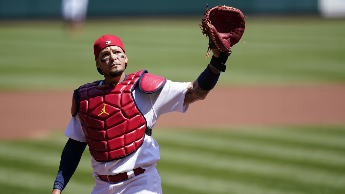 St. Louis Cardinals catcher Yadier Molina waves to cheering fans after starting a baseball game...