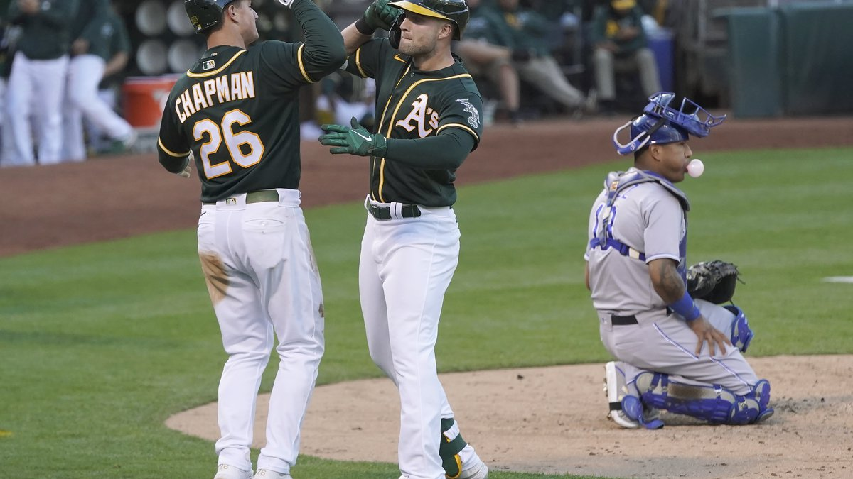 Oakland Athletics' Seth Brown, center, celebrates after hitting a two-run home run that also...