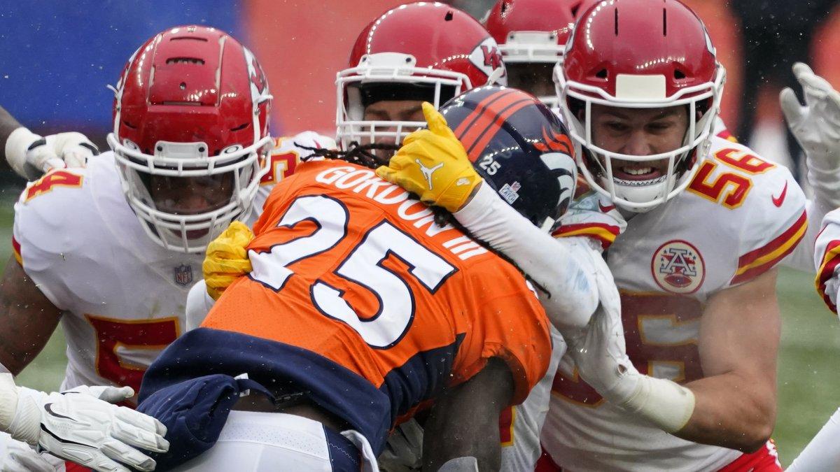 Denver Broncos running back Melvin Gordon (25) is brought down by Kansas City Chiefs linebacker...