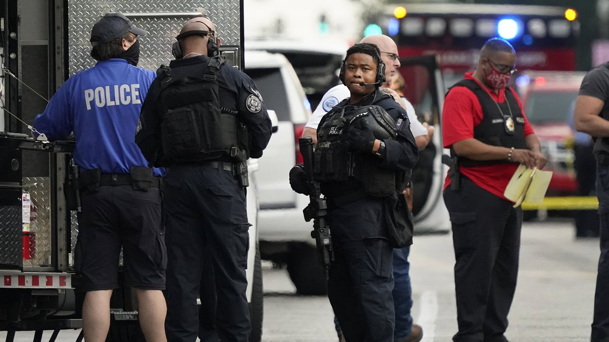 Police work near the scene of a shooting Saturday, Aug. 29, 2020, in St. Louis. The St. Louis...