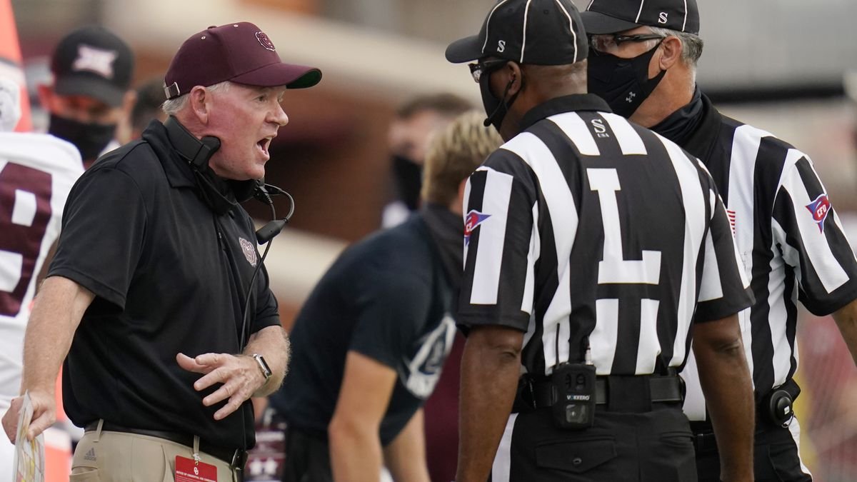 Missouri State head coach Bobby Petrino talks with officials in the first half of an NCAA...