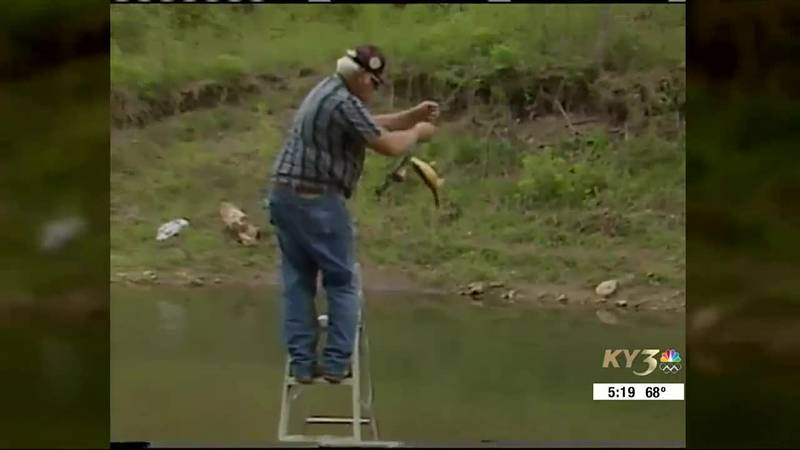 Former Sucker Days champion grabber, Rex Harp pulling a sucker from the river.