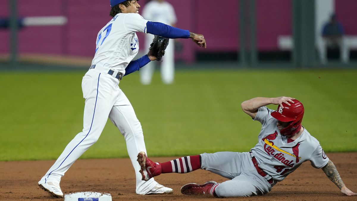 Kansas City Royals shortstop Adalberto Mondesi, left, forces out St. Louis Cardinals Tyler O'Neill (41) during the second inning of a baseball game in Kansas City, Mo., Monday, Sept. 21, 2020. (AP Photo/Orlin Wagner)