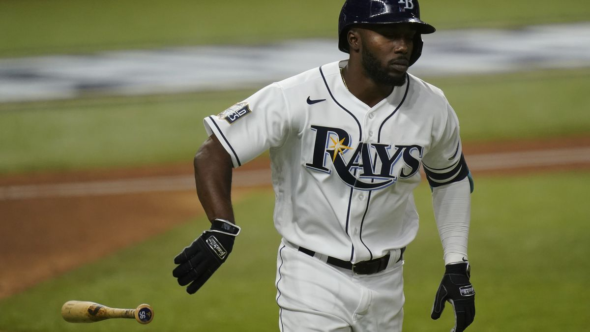 Tampa Bay Rays' Randy Arozarena rounds the bases after a home run during the ninth inning in...