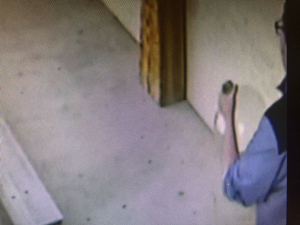 Security video shows the man running across the parking lot with the donations jar.