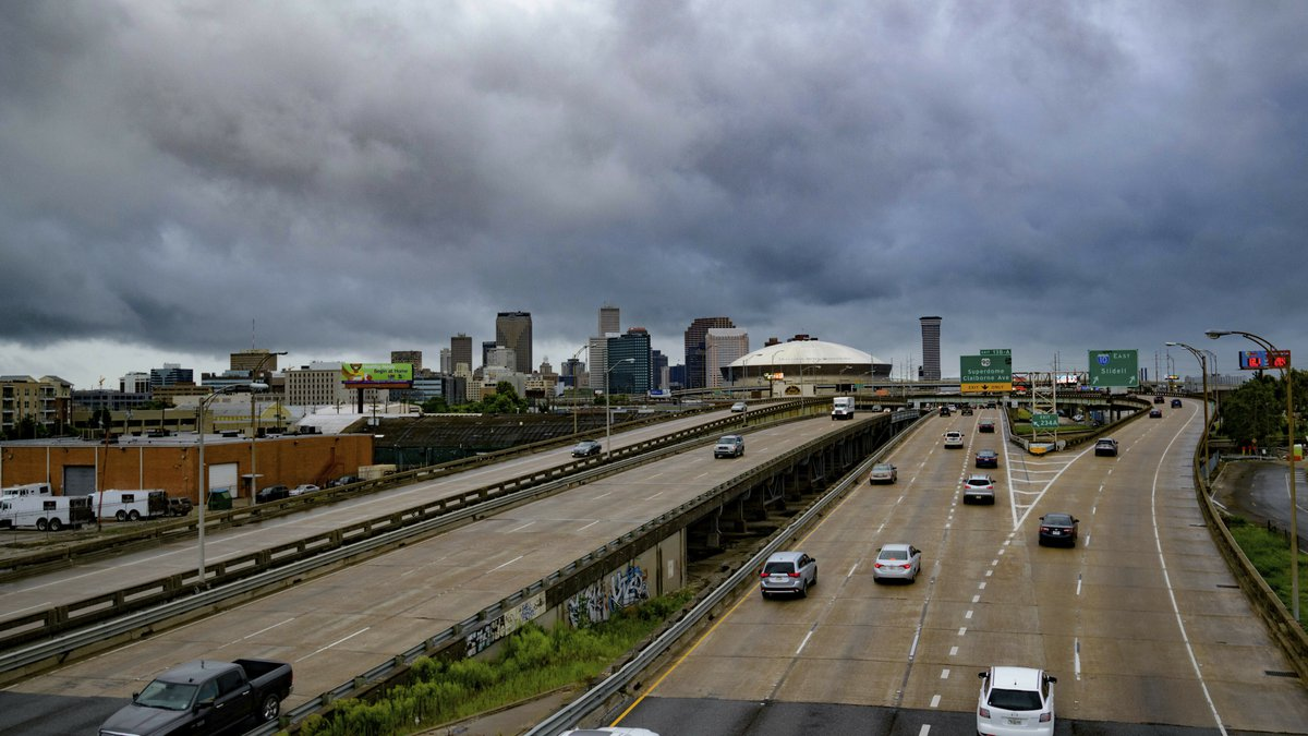 Vehicles make their way on I-10 as bands of rain from Tropical Storm Barry from the Gulf of...