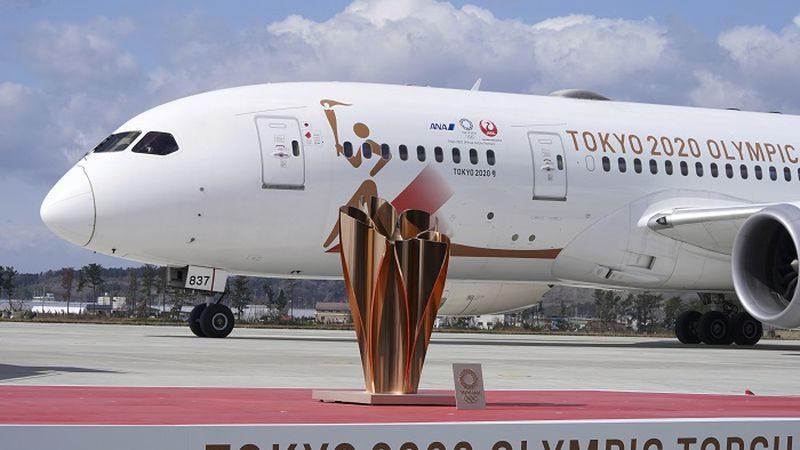 A plane carrying the Olympic flame arrives before Olympic Flame Arrival Ceremony at Japan Air...