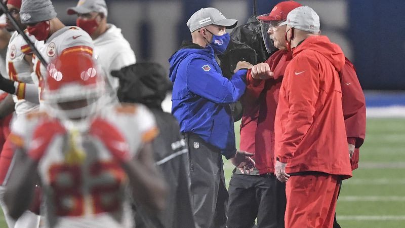 Kansas City Chiefs head coach Andy Reid, right, greets Buffalo Bills head coach Sean McDermott...