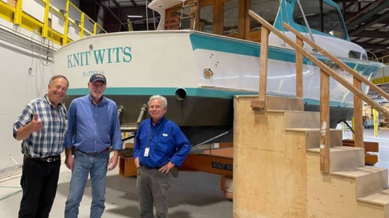 Johnny Morris with 40+ year Hatteras veterans Alden Harris and Bob Arthur in front of the very...