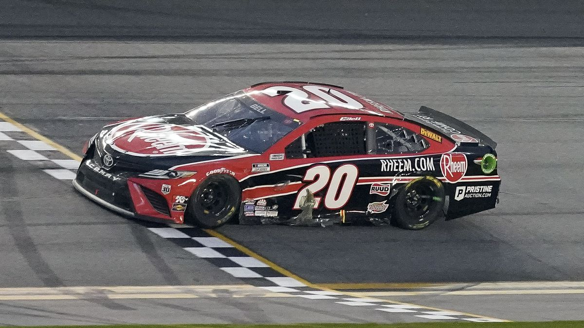 Christopher Bell crosses the finish line to win the NASCAR Cup Series road course auto race at...