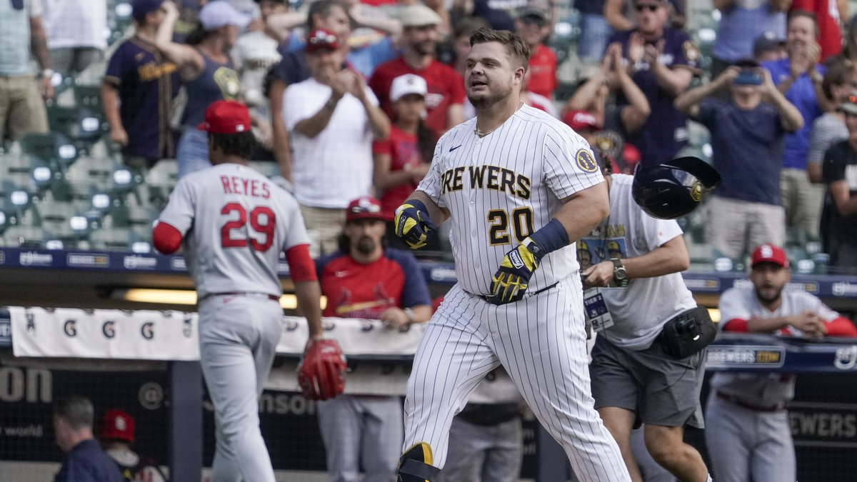 Milwaukee Brewers' Daniel Vogelbach celebrates after hitting a walk-off grand slam during the...