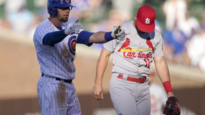 Chicago Cubs' Eric Sogard, left, celebrates after hitting a double as St. Louis Cardinals...