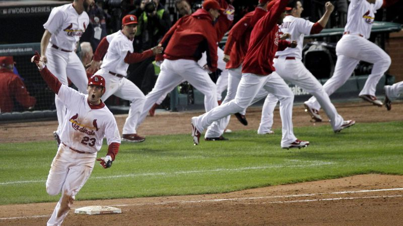 St. Louis Cardinals' David Freese reacts after hitting a solo home run off a pitch by Texas...