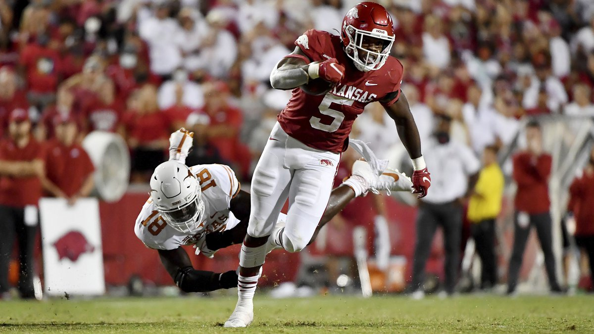 Arkansas running back Raheim Sanders (5) sheds Texas defender Ovie Oghoufo (18) as he runs for...