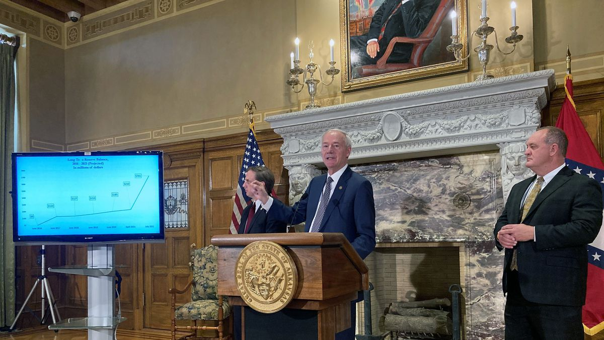 Arkansas Gov. Asa Hutchinson speaks at a news conference at the state Capitol in Little Rock,...