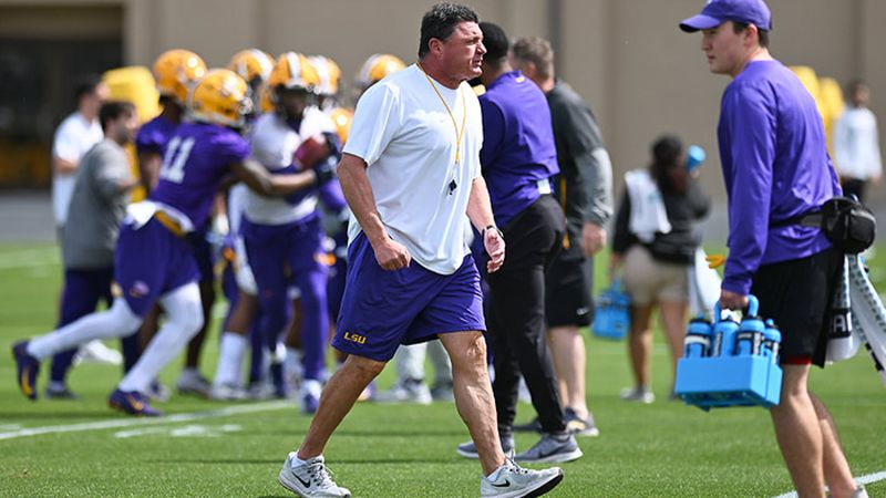 LSU head coach Ed Orgeron is shown at a spring practice in early March before everything was...